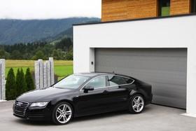 Секционные или роллетные: выбираем идеальные ворота для гаража