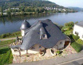 15 примеров необычных крыш домов